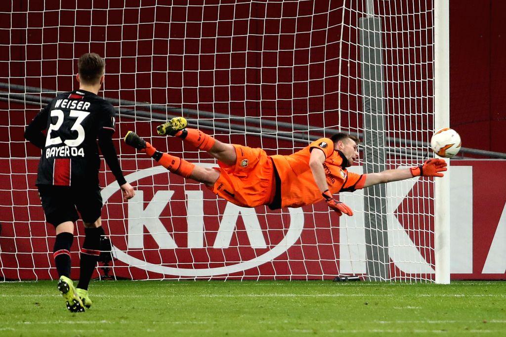 LEVERKUSEN, Feb. 22, 2019 - Goalkeeper Lukas Hradecky (R) of Leverkusen saves a shot during the UEFA Europa League round of 32 second leg soccer match between Bayer 04 Leverkusen and FC Shakhtar ...