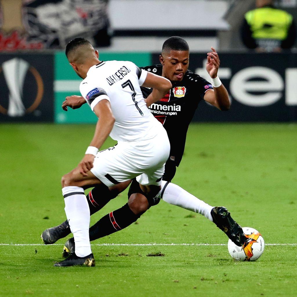 LEVERKUSEN, Feb. 22, 2019 - Wanderson (L) of Krasnodar vies with Leon Bailey of Leverkusen during the UEFA Europa League round of 32 second leg soccer match between Bayer 04 Leverkusen and FC ...