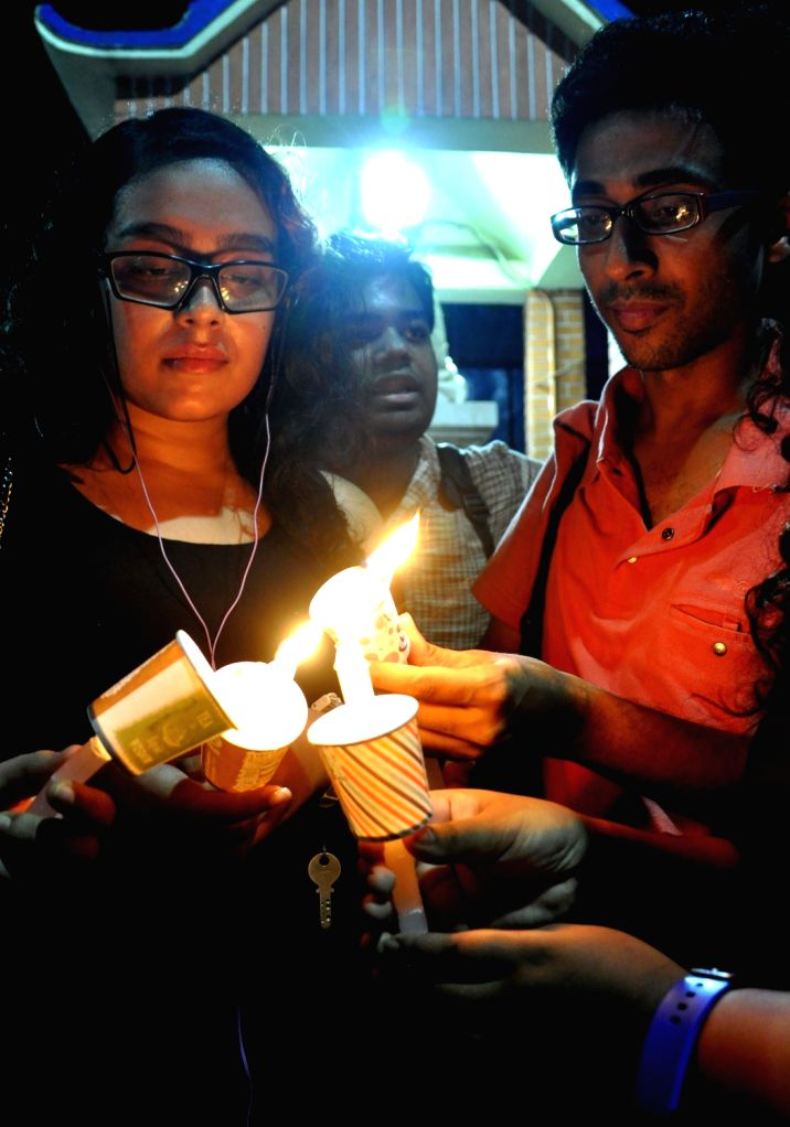LGBT supporters pay tribute to Orlando victims in Kolkata on June 18, 2016.
