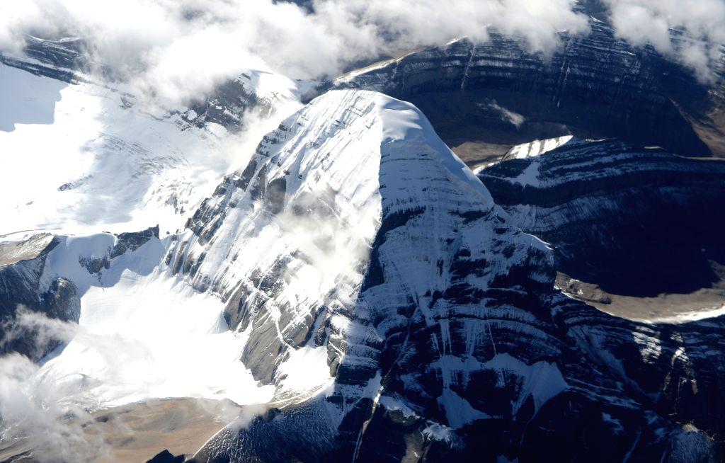 "Photo taken on Aug. 17, 2014 shows an aerial view of the ""holy mountain"", the Kangrinboqe, in Ngari Prefecture, southwest China's Tibet Autonomous Region. .."