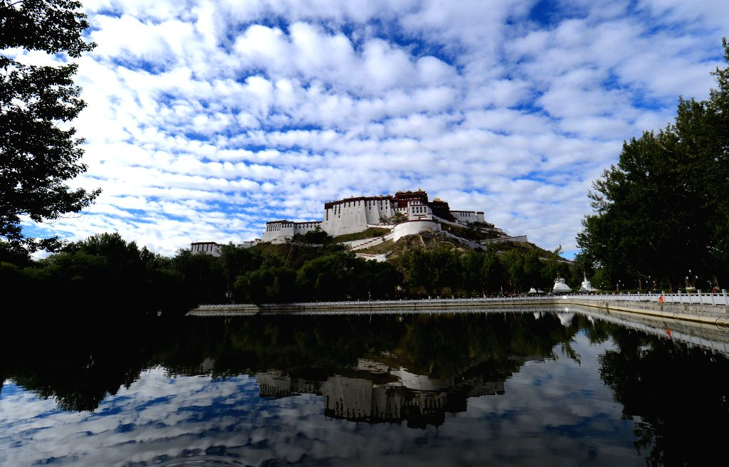 Photo taken on July 4, 2014 shows the Potala Palace under the sky in Lhasa, capital of southwest China's Tibet Autonomous Region.