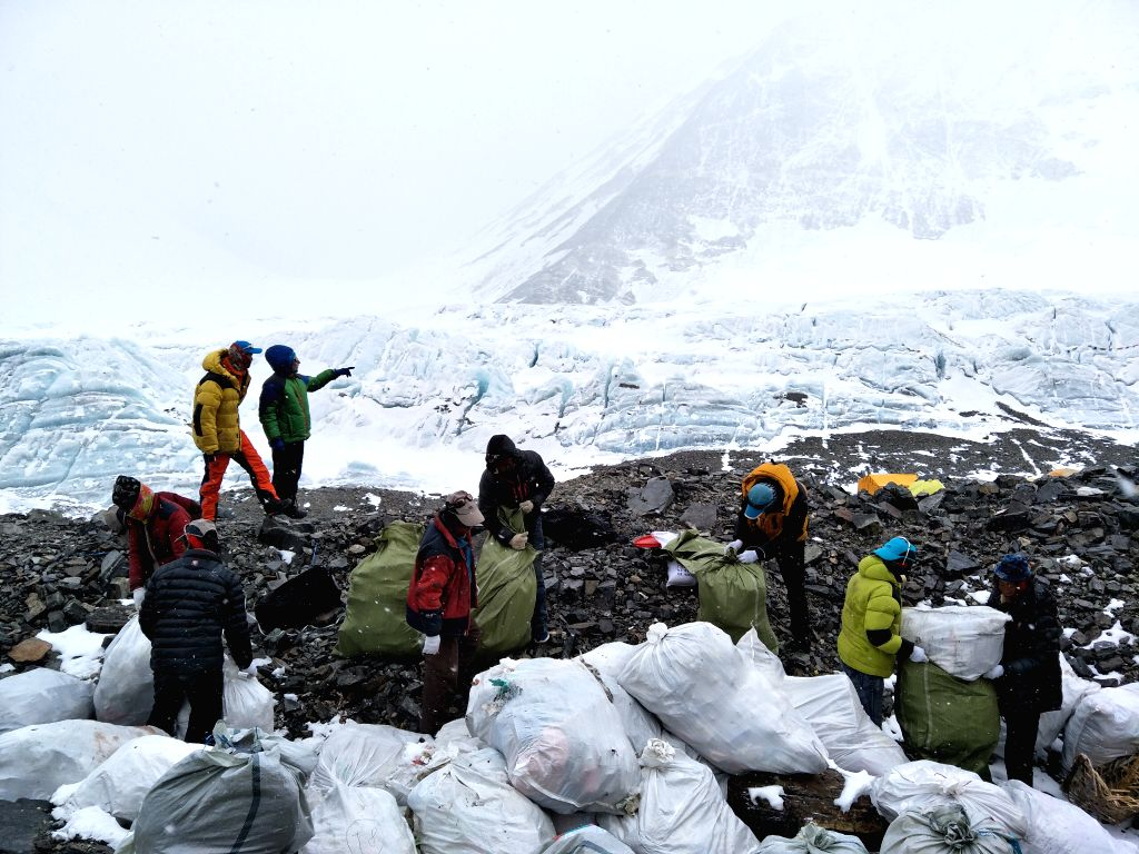 LHASA, May 10, 2017 - People collect wastes at the north slope of the Mount Qomolangma in southwest China's Tibet Autonomous Region, May 8, 2017. The nine-day cleaning campaign kicked off on May 6, ...