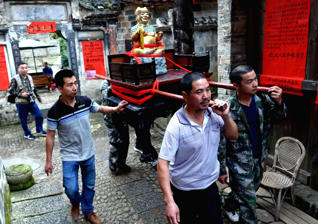 LIANCHENG, April 16, 2017 - People of Peitian village walk a God of Cereals during an annual farming culture festival in Peitian village of Liancheng County, southeast China's Fujian Province, April ...