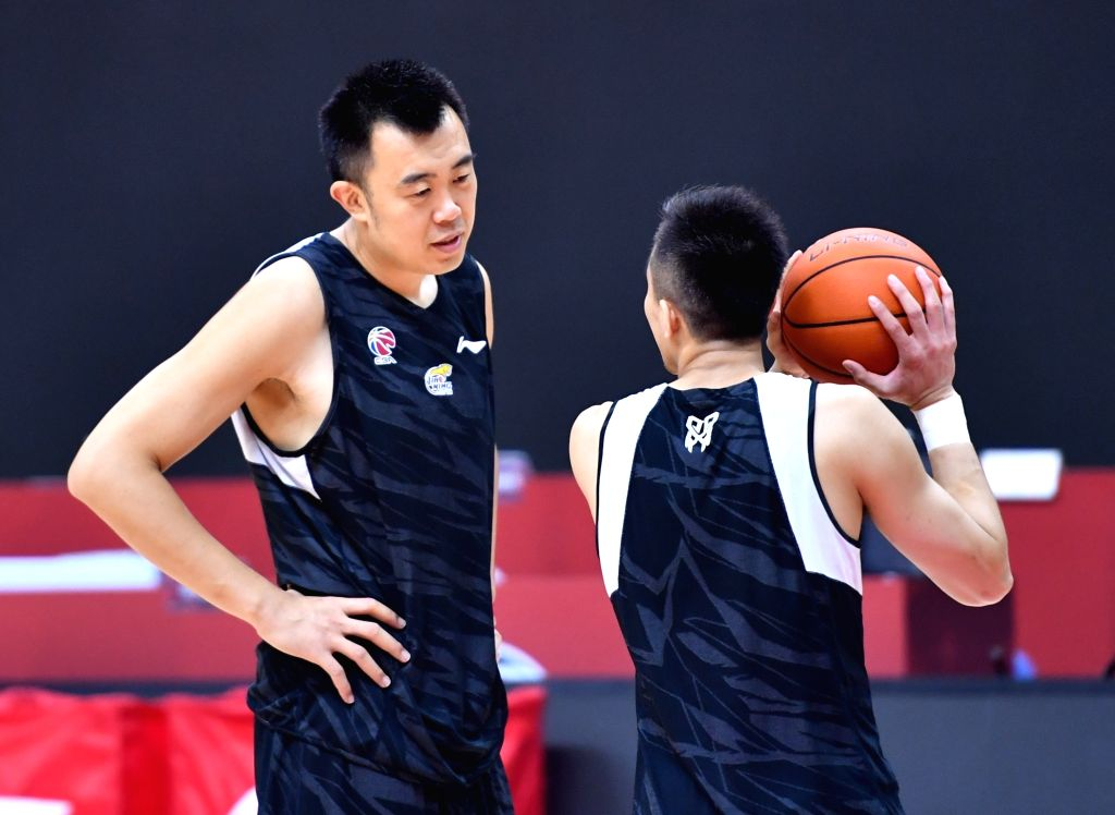 Liaoning Flying Leopards' Han Dejun (L) talks during a training session before the second game of the final round against Guangdong Southern Tigers at the 2019-2020 ...