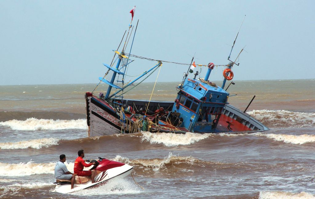 Life guards approach a fishing trawler that capsized at Miramar, Goa on Tuesday night (9th September); on Sept 10, 2014. No casualty was reported, the 31 crew members were rescued by the lifeguards.