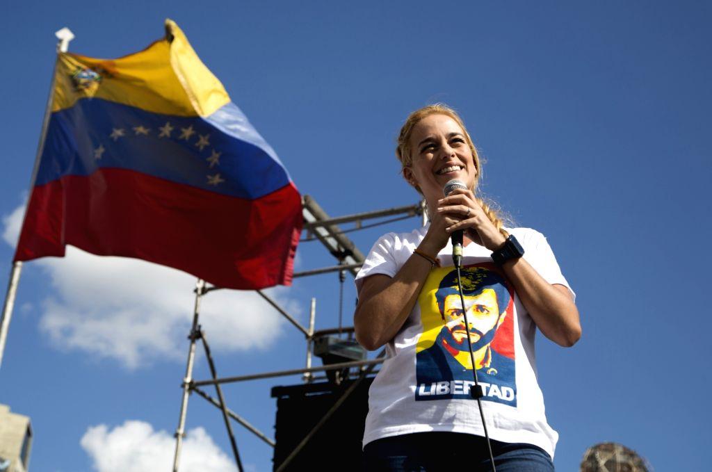 Lilian Tintori, wife of the opposition Venezuelan leader Leopoldo Lopez, delivers a speech during a demonstration in Caracas, Venezuela, on Nov. 29, 2015. On Dec. ...
