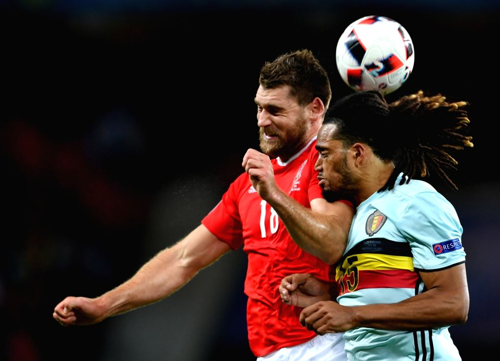 LILLE, July 2, 2016 - Sam Vokes of Wales (L) vies with Jason Denayer of Belgium during the Euro 2016 quarterfinal match between Belgium and Wales in Lille, France, July 1, 2016. Wales won 3-1.