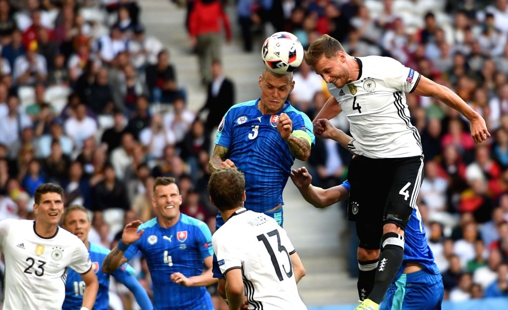 LILLE, June 27, 2016 - Benedikt Howedes(1st R) of Germany vies with Martin Skrtel(2nd R) of Slovakia during their Euro 2016 round of 16 football match in Lille, France, June 26, 2016. Germany won 3-0.