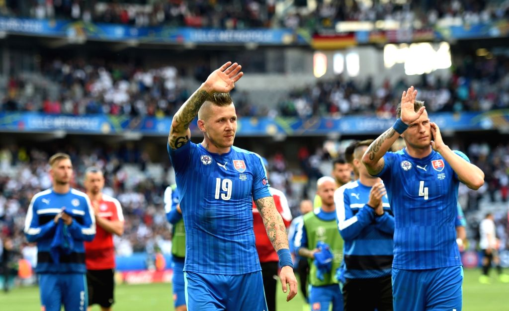 LILLE, June 27, 2016 - Juraj Kucka(C) of Slovakia and his teammates gesture to audiece after the Euro 2016 round of 16 football match between Germany and Slovakia in Lille, France, June 26, 2016. ...