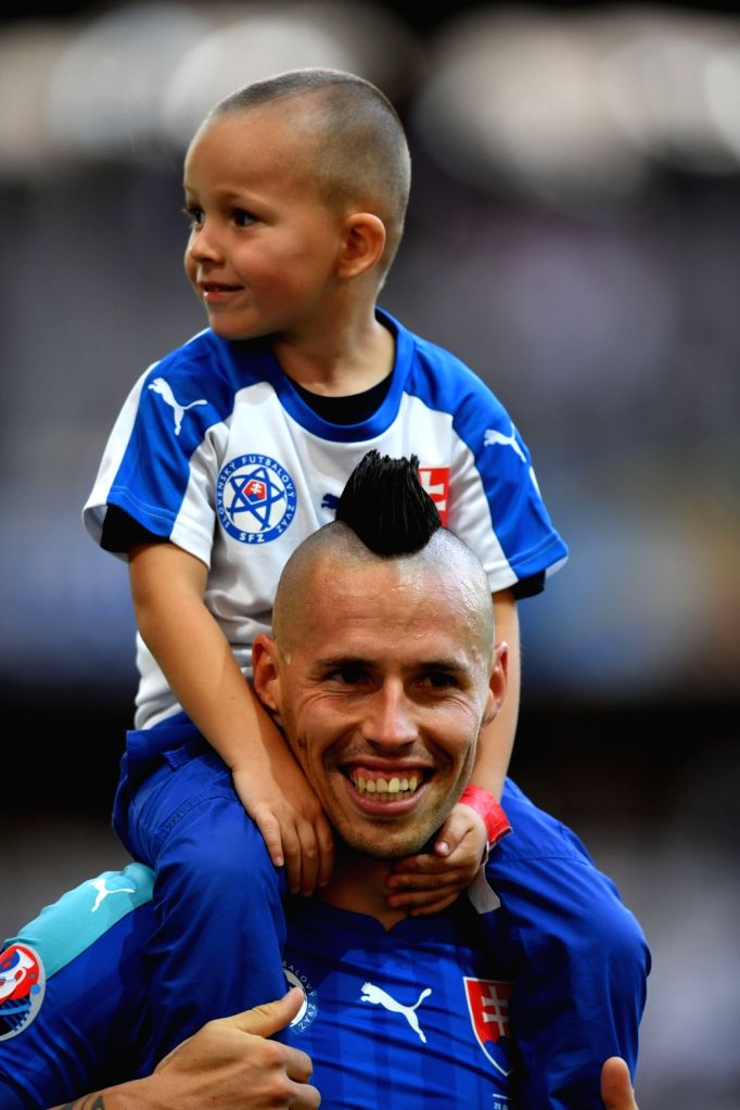 LILLE, June 27, 2016 - Marek Hamsik of Slovakia plays with his son after the Euro 2016 round of 16 football match between Germany and Slovakia in Lille, France, June 26, 2016. Germany won 3-0.