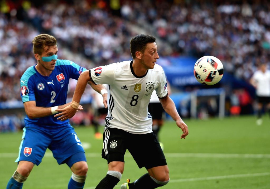 LILLE, June 27, 2016 - Mesut Ozil(R) of Germany competes during the Euro 2016 round of 16 football match between Germany and Slovakia in Lille, France, June 26, 2016. Germany won 3-0.