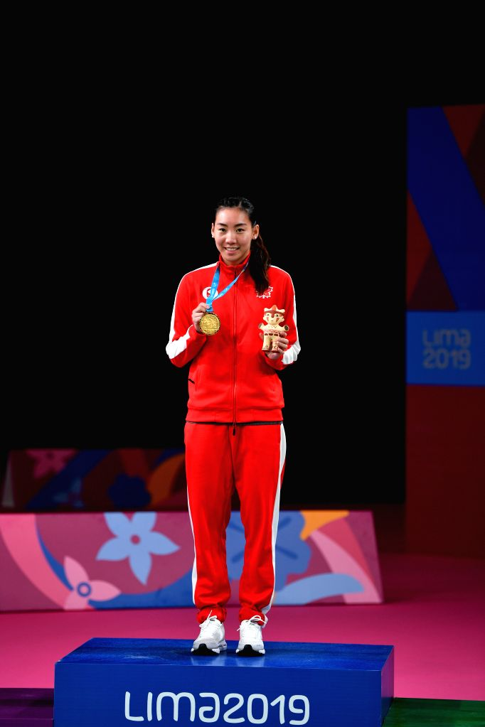 LIMA, Aug. 3, 2019 - Winner Michelle Li of Canada celebrates on the podium during the awarding ceremony of the women's singles event at Pan American Games 2019 in Lima, Peru on August 2, 2019.