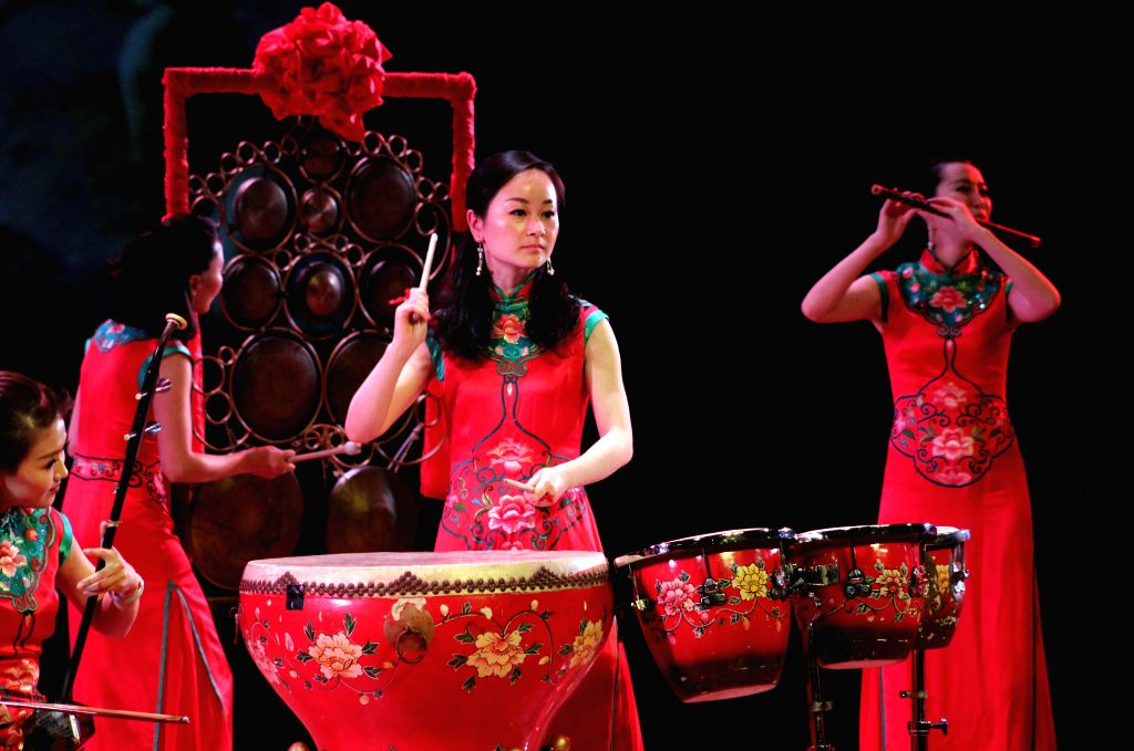 """Members of Zhejiang's Theater of Dance and Singing, perform """"Butterfly Girls Band"""", at Lima City Municipal Theater, in Lima, Peru, on Jan. 18, 2015. ..."""
