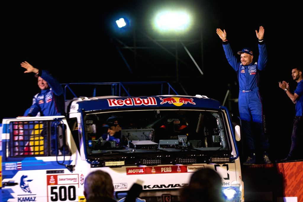 LIMA, Jan. 7, 2019 (Xinhua) -- Russian driver Eduard Nikolaev (2nd R) of Kamaz team poses on the podium during the departure ceremony at the 2019 Dakar Rally Race, Lima, Peru, on Jan. 6, 2019. The 41st edition of Dakar Rally Race kicked off in Lima,