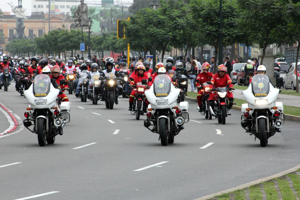 """Members of the Police guard the """"Patriotic Motorcycle Parade 2014"""" in Lima city, capital of Peru, on July 20, 2014. Motorcyclists took part in the Patriotic ."""