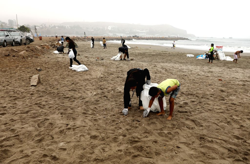 LIMA, June 9, 2019 - Volunteers clean up the beach in Lima, Peru, June 8, 2019. People in Lima participated in a voluntary event to mark the World Oceans Day, a UN-designated day held annually on ...