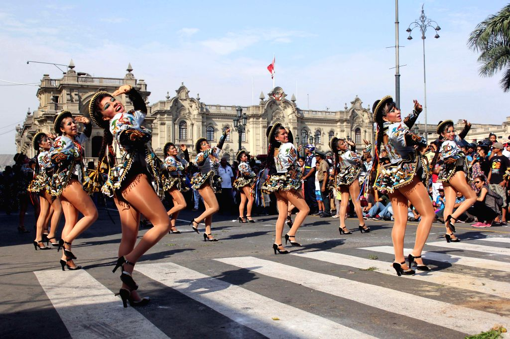 """Dancers perform during the parade of """"Carnivals of Lima"""", in Lima, capital of Peru, on Feb. 28, 2015."""