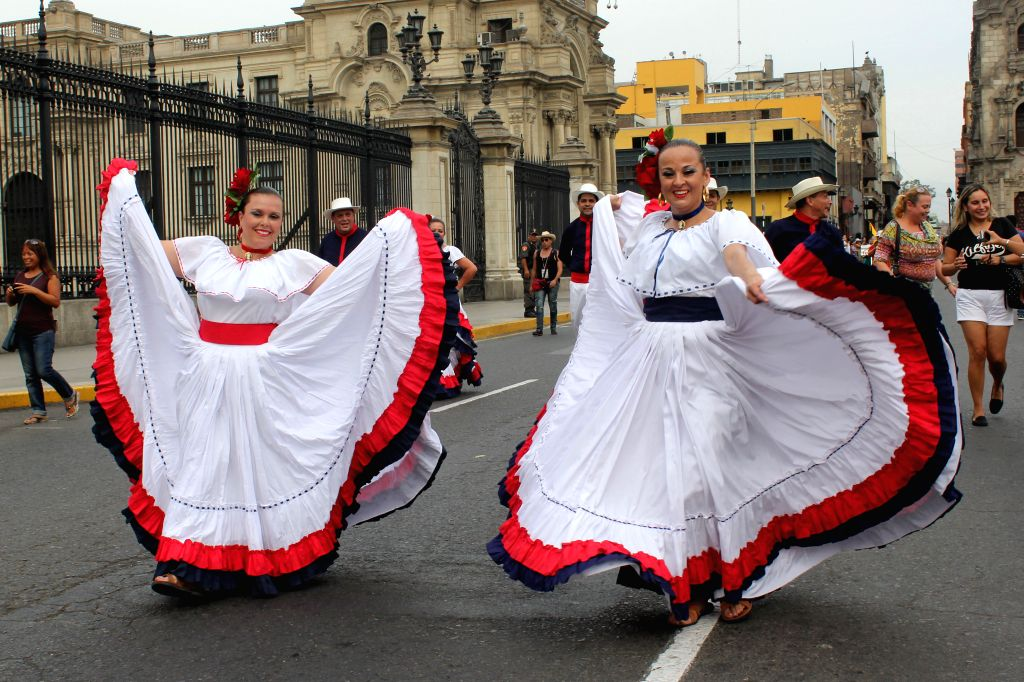 "Costa Rican dancers perform during the ""Parade of the World Cultures"" in the framework of the 8th International Meeting of Folklore ""My Peru ..."