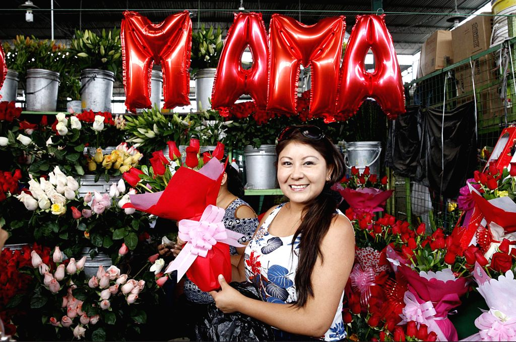 LIMA, May 15, 2017 - A woman sells flowers at a market on Mother's Day in Lima, Peru, on May 14, 2017.