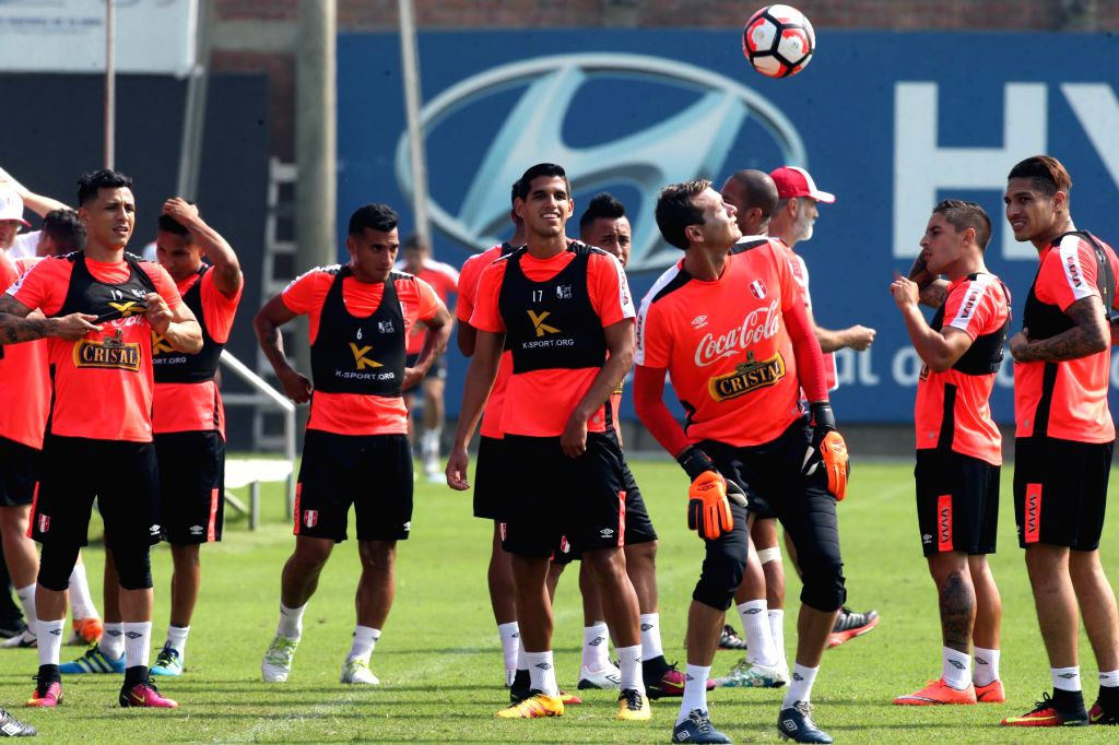 LIMA, May 26, 2016 - Peru's National Soccer Team players take part in a training session at the National Sport Village, in Lima, capital of Peru, on May 25, 2016. The Peru's National Soccer Team had ...