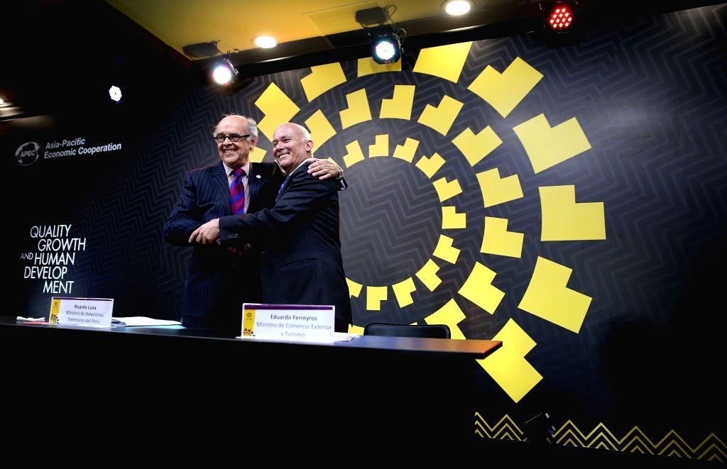 LIMA, Nov. 18, 2016 - Peruvian Foreign Minister Ricardo Luna Mendoza (L) hugs Peruvian Minister for Foreign Trade and Tourism Eduardo Ferreyros after a press conference of the APEC Ministerial ... - Ricardo Luna Mendoza