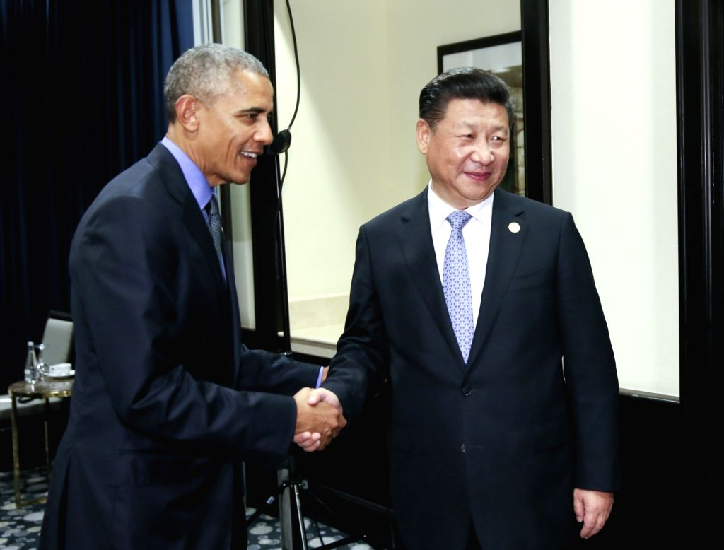 LIMA, Nov. 19, 2016 - Chinese President Xi Jinping (R) meets with his U.S. counterpart Barack Obama in Lima, Peru, Nov. 19, 2016.
