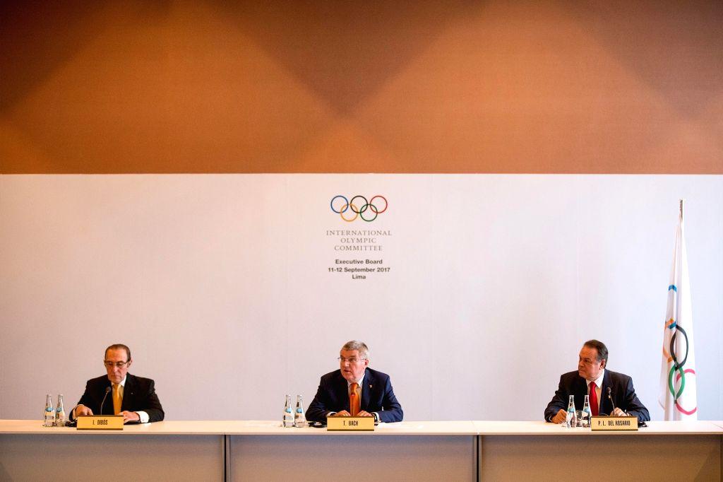 LIMA, Sept. 12, 2017 - International Olympic Committee (IOC) President Thomas Bach (C), IOC member of Peru Ivan Dibos (L) and President of the Peruvian Olympic Committee Pedro Del Rosario attend the ...