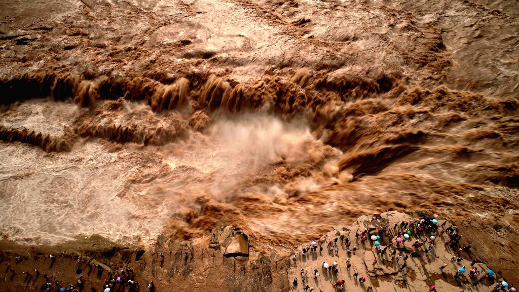 LINFEN, Aug. 5, 2018 - Aerial photo taken on Aug. 4, 2018 shows the Hukou Waterfall of the Yellow River in the flood season in Jixian County of Linfen City, north China's Shanxi Province.