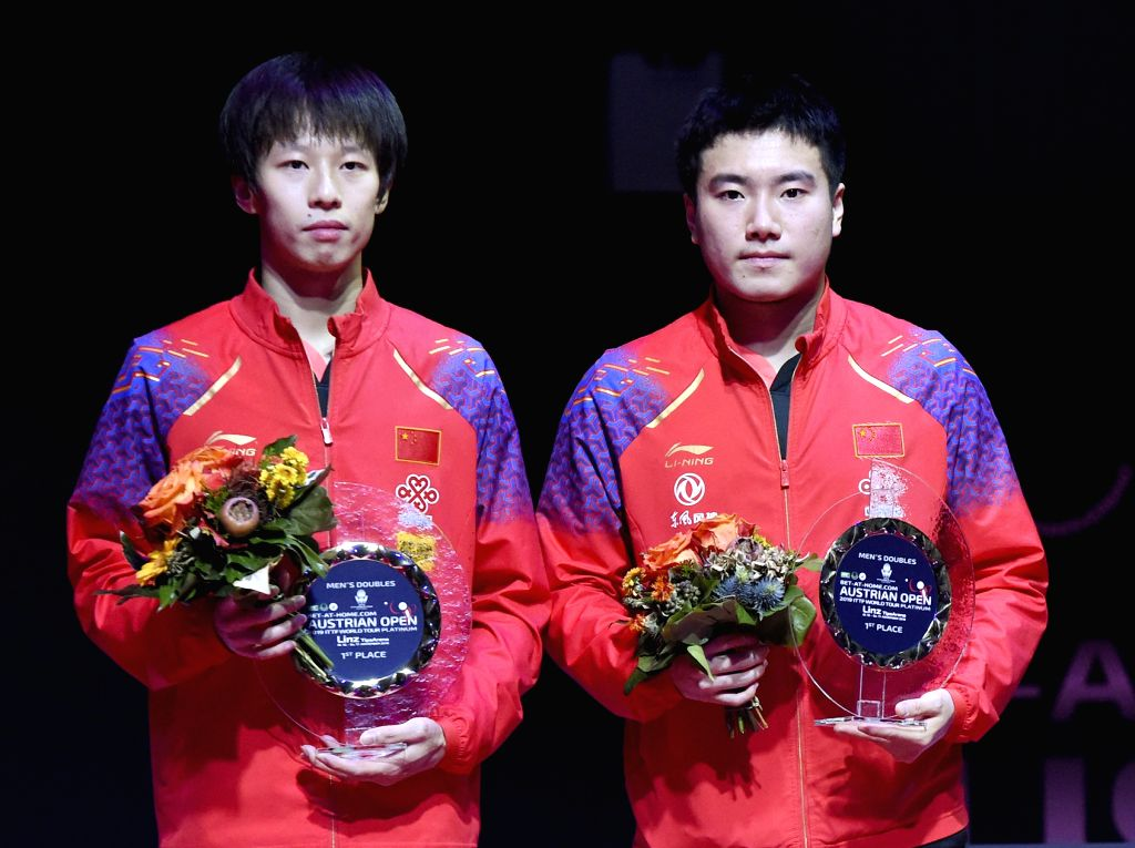 Linz, Nov. 17, 2019 - Winners Liang Jingkun (R)/Lin Gaoyuan of China pose for photos during the awarding ceremony of the men's doubles final against Jeoung Youngsik/Lee Sangsu of South Korea at the ...