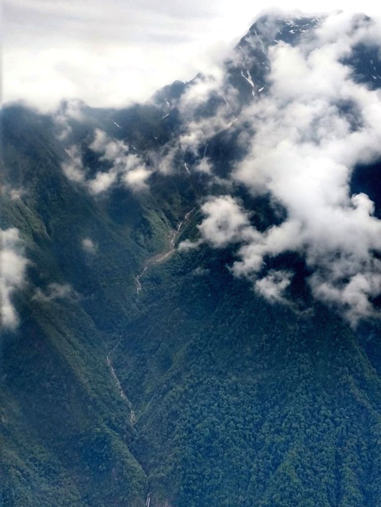 Lipo: The presence of clouds associated with rains hamper a search operation to retrieve the mortal remains of six of the 13 persons killed in the AN-32 aircraft crash in Arunachal Pradesh on June 3; in Lipo area, northeast of Tato under West Siang d - Ratnakar Singh
