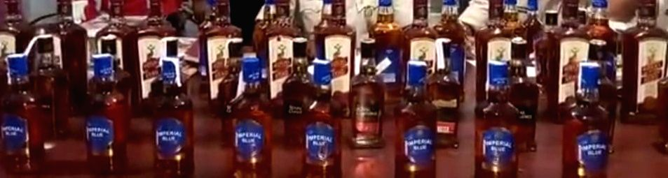 Liquor recovered from a police vehicle carrying 'logos', 2 arrested.