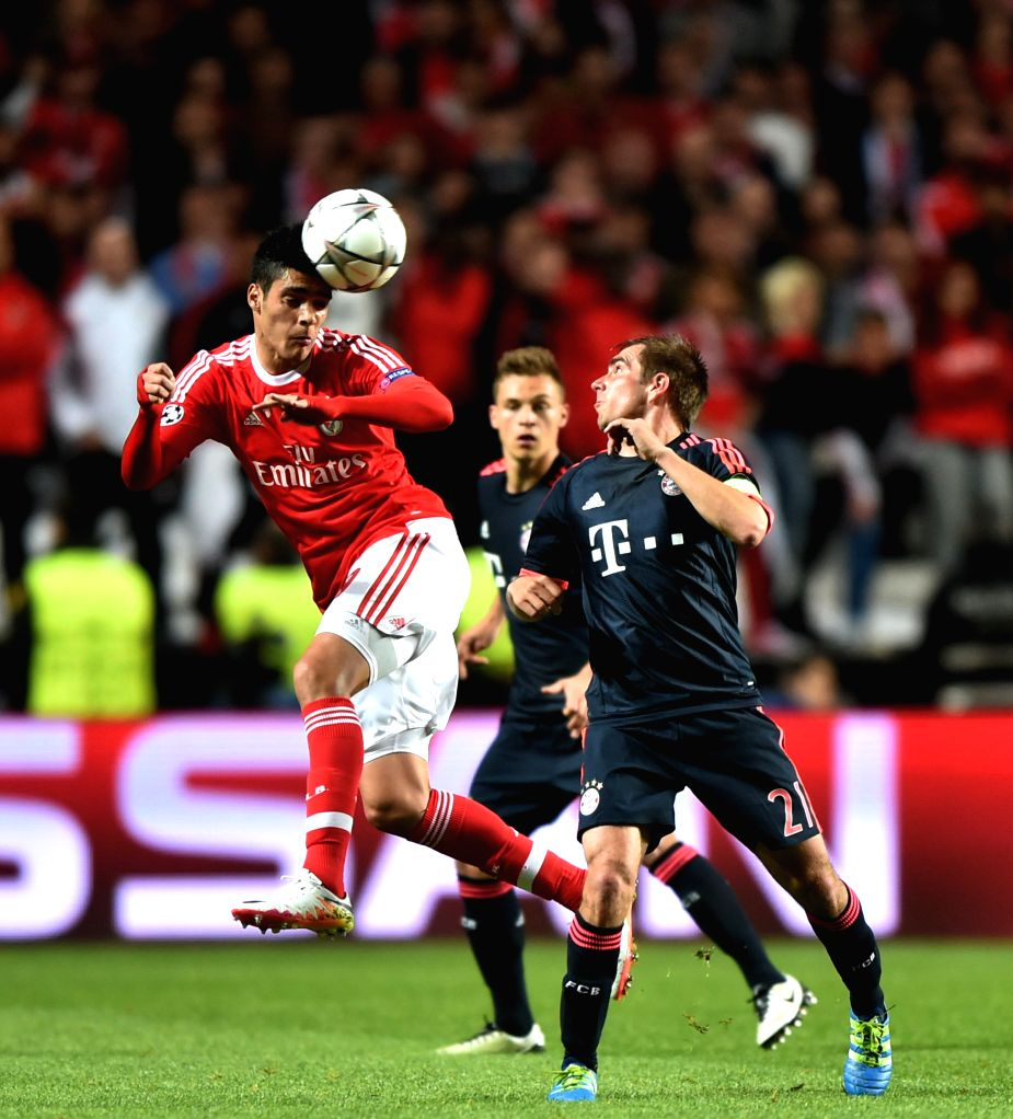 LISBON, April 14, 2016 - SL Benfica's Raul Jimenez (L) vies with FC Bayern Munich's Philipp Lahm during the second leg of quarterfinals of the Eurpean Champions League soccer match at the Luz stadium ...