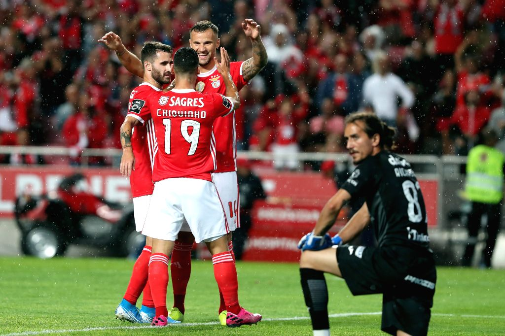 LISBON, Aug. 11, 2019 - Benfica's Haris Seferovic (2nd R) celebrates after scoring during the Portuguese league football match between Benfica and Pacos de Ferreira in Lisbon, Portugal, on Aug. 10, ...