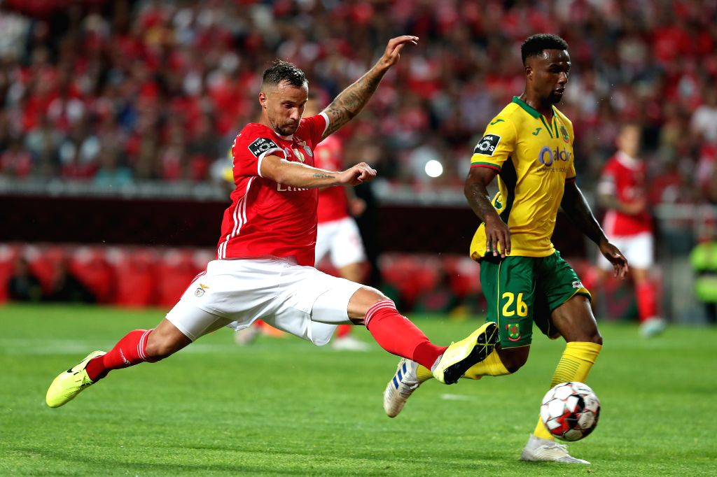 LISBON, Aug. 11, 2019 - Benfica's Haris Seferovic (L) vies with Pacos de Ferreira's Maracas during the Portuguese league football match between Benfica and Pacos de Ferreira in Lisbon, Portugal, on ...