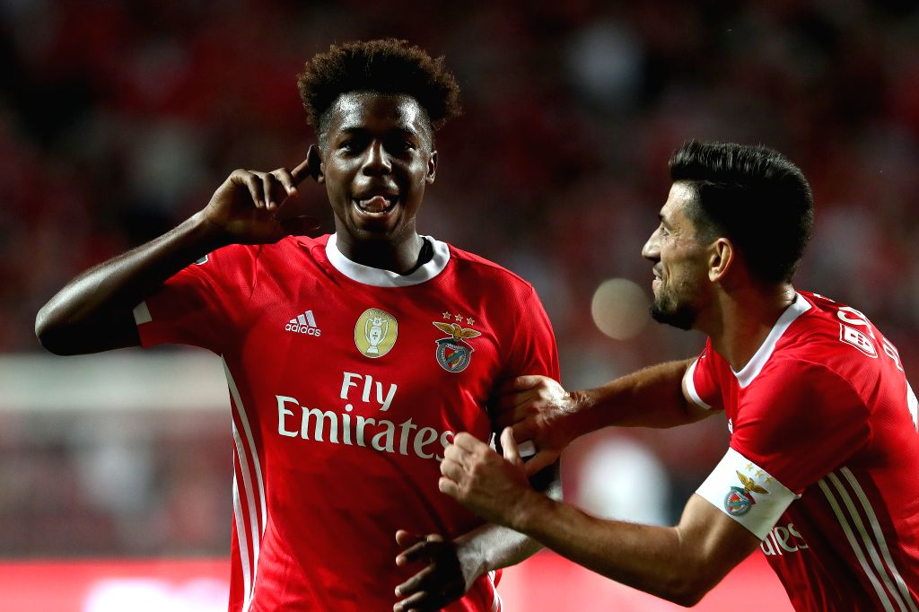LISBON, Aug. 11, 2019 - Benfica's Nuno Tavares (L) celebrates after scoring during the Portuguese league football match between Benfica and Pacos de Ferreira in Lisbon, Portugal, on Aug. 10, 2019.
