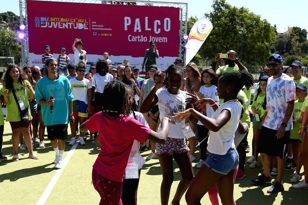 LISBON, Aug. 12, 2019 - People attend activities during the International Youth Day at the Jamor National Sports Center in Lisbon, Portugal, on Aug. 12, 2019. The United Nations has set the theme ...