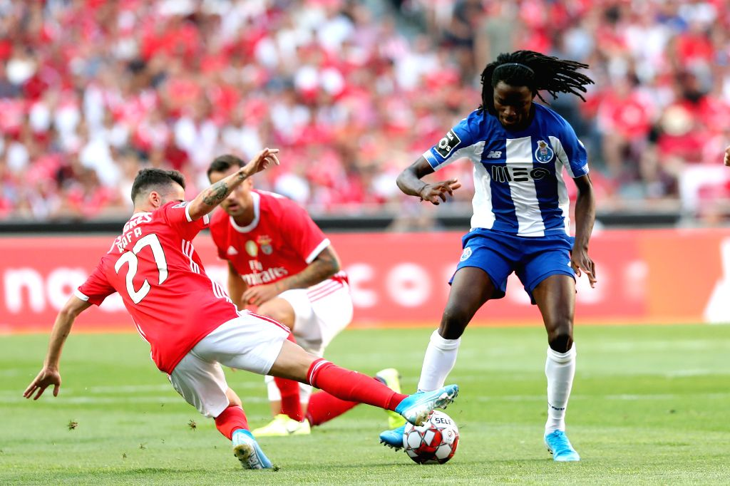 LISBON, Aug. 25, 2019 - Romario Baro (R) of FC Porto vies with Rafa Silva of SL Benfica during the Portuguese League football match between SL Benfica and FC Porto at the Luz stadium in Lisbon on ...