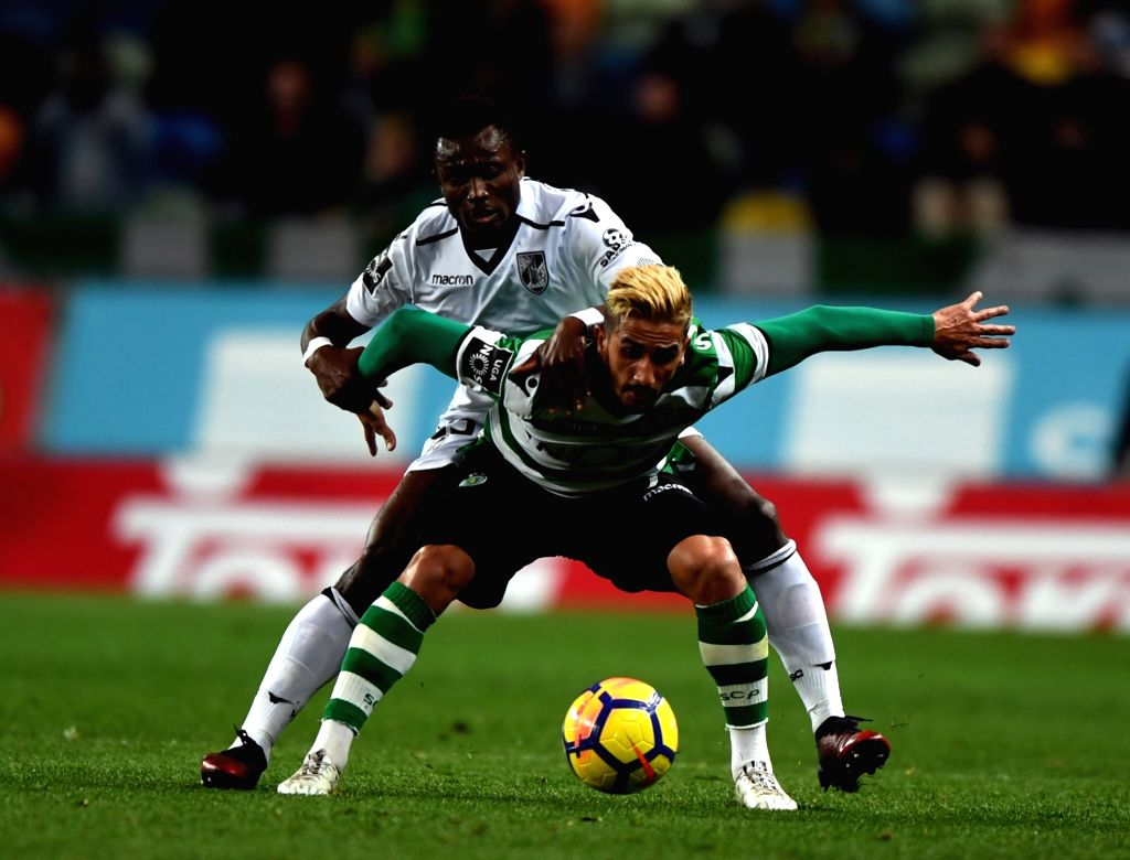 LISBON, Feb. 1, 2018 - Ruben Ribeiro (Front) of Sporting vies with Konan of Guimaraes during the Portuguese League soccer match between Sporting and Vitoria Guimaraes in Lisbon, Portugal, Jan. 31, ...