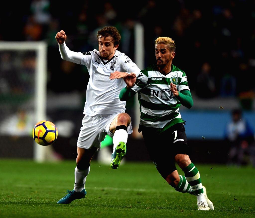 LISBON, Feb. 1, 2018 - Ruben Ribeiro (R) of Sporting vies with Rafael Miranda of Guimaraes during the Portuguese League soccer match between Sporting and Vitoria Guimaraes in Lisbon, Portugal, Jan. ...
