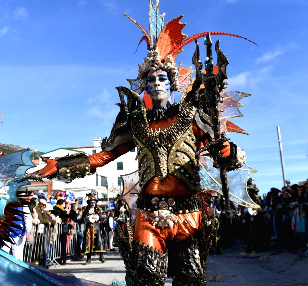 LISBON, Feb. 14, 2018 - A reveller participates in a samba parade during the carnival in Sesimbra, Portugal, on Feb. 13, 2018.