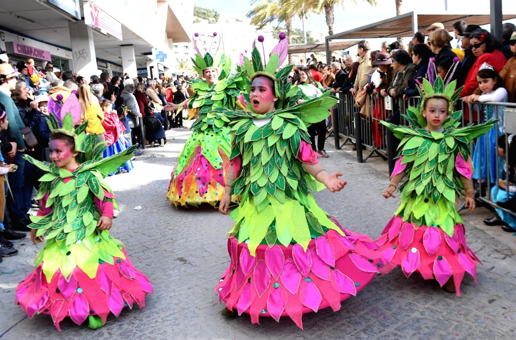LISBON, Feb. 14, 2018 - Revellers participate in a samba parade during the carnival in Sesimbra, Portugal, on Feb. 13, 2018. (Xinhua/Zhang Liyun)