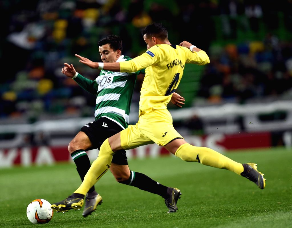 LISBON, Feb. 15, 2019 - Marcos Acuna (L) of Sporting vies with Ramiro Funes Mori of Villarreal during the UEFA Europa League round of 32 first leg soccer match between Sporting CP and Villarreal in ...