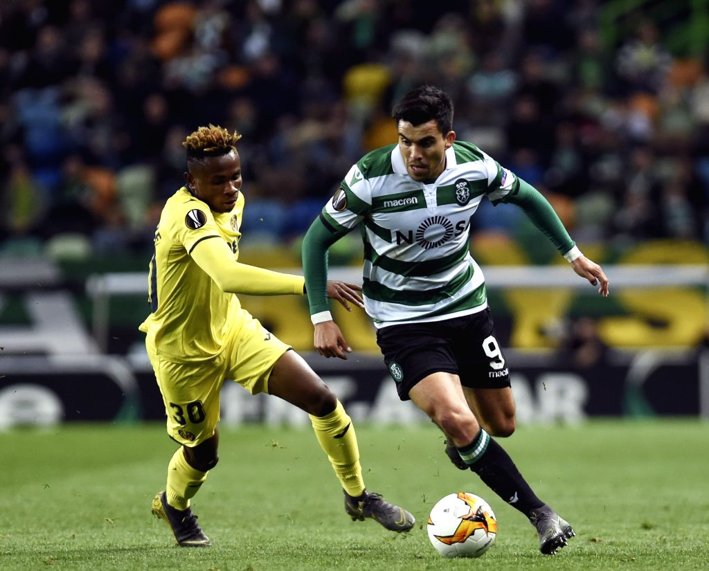 LISBON, Feb. 15, 2019 - Marcos Acuna (R) of Sporting vies with Samuel Chimerenka Chukwueze of Villarreal during the UEFA Europa League round of 32 first leg soccer match between Sporting CP and ...