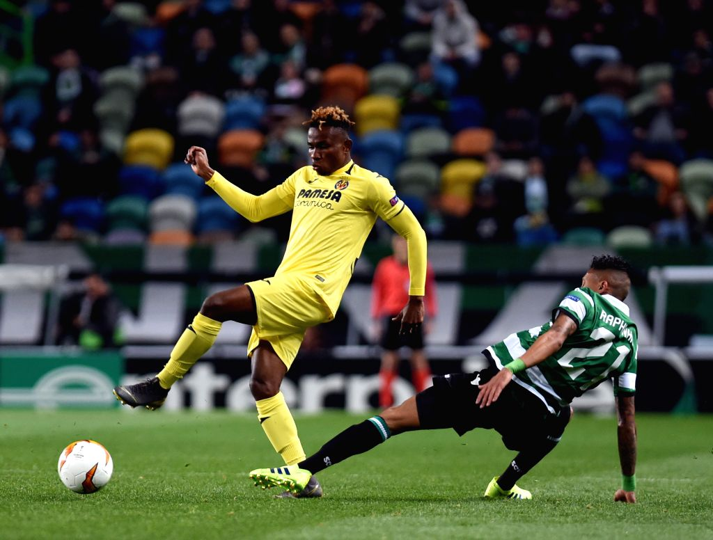 LISBON, Feb. 15, 2019 - Raphinha (R) of Sporting vies with Samuel Chimerenka Chukwueze of Villarreal during the UEFA Europa League round of 32 first leg soccer match between Sporting CP and ...