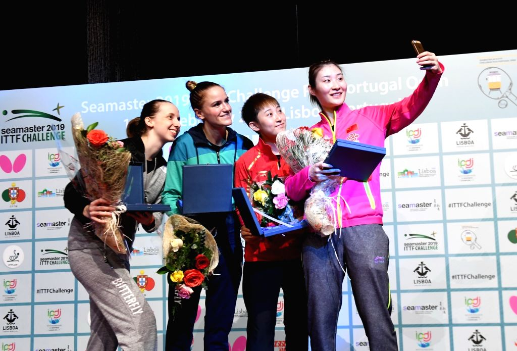 LISBON, Feb. 18, 2019 - China's Fan Siqi (2nd R) and Yang Huijing (1st R) pose for a selfie with Hungary's Dora Madarasz/Szandra Pergel during the awarding ceremony after the women's doubles final at ...