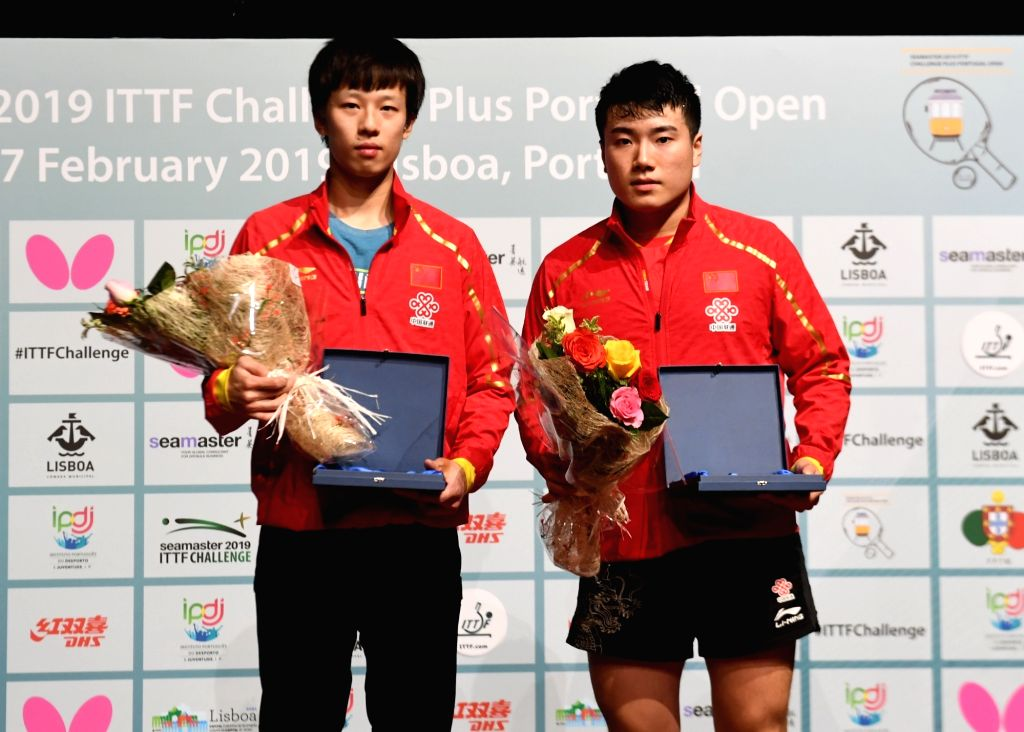LISBON, Feb. 18, 2019 - China's Liang Jingkun (R) and Lin Gaoyuan pose on the podium during the awarding ceremony after the men's singles final at the 2019 ITTF Challenge Plus Portugal Open in ...