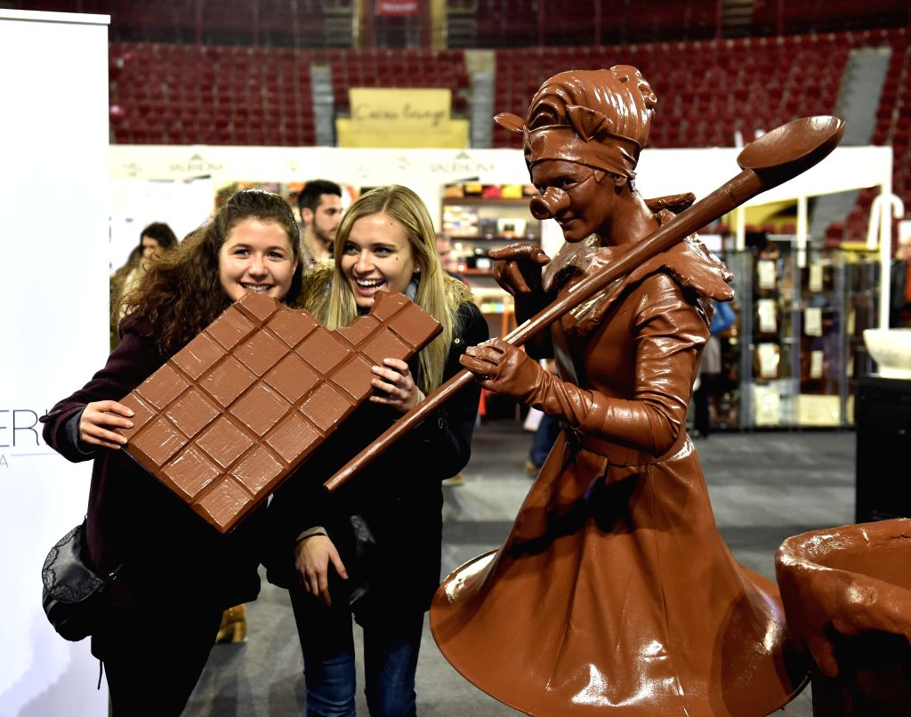 Visitors pose with  a chocolate man during a chocolate fair at Campo Pequeno Square in Lisbon, capital of Portugal, Feb. 5, 2015. Lisbon's chocolate fair kicked off ..
