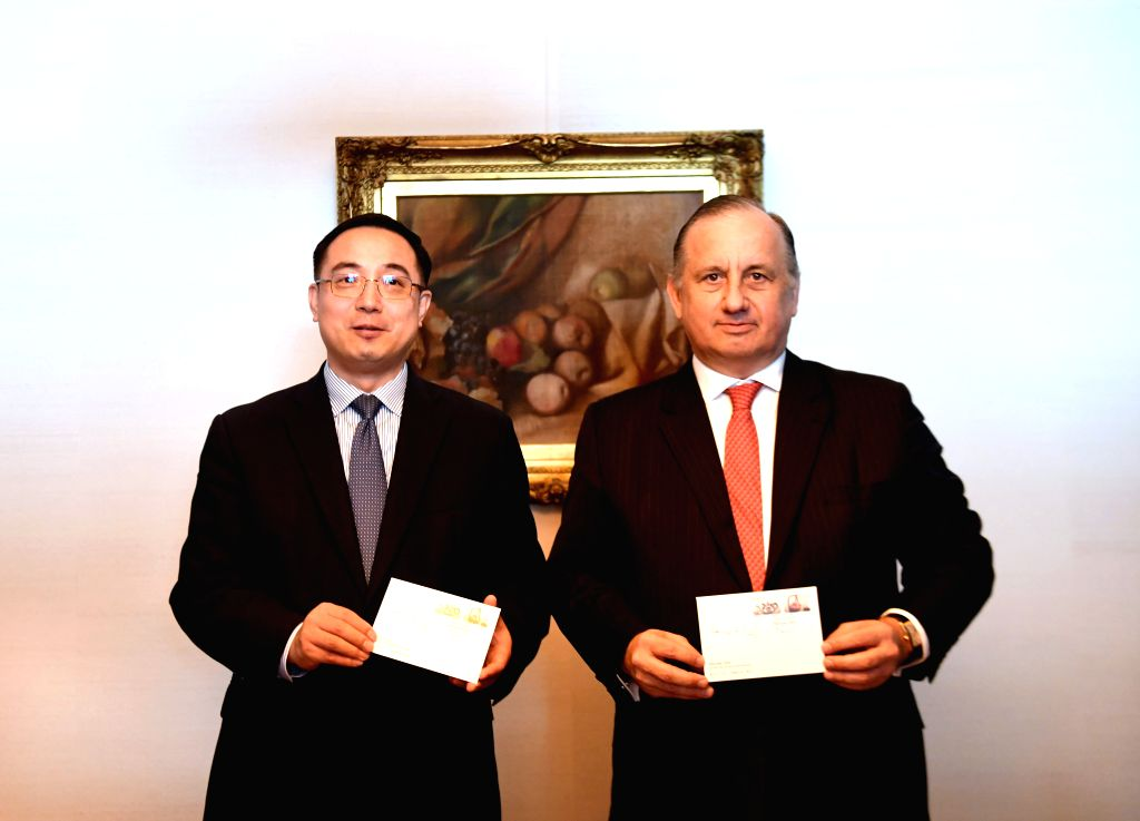 LISBON, Feb. 8, 2019 - Chinese Ambassador to Portugal Cai Run (L) and the Portuguese post office CTT CEO Francisco de Lacerda present the first day covers at a stamp issuance ceremony to celebrate ...