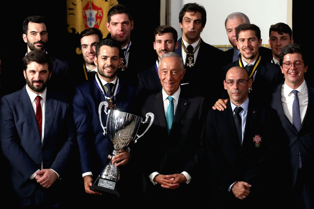 LISBON, July 17, 2019 - Portuguese President Marcelo Rebelo de Sousa (center, front row) and Portugal's national Roller Hockey team pose with the trophy during the awarding ceremony for the ...