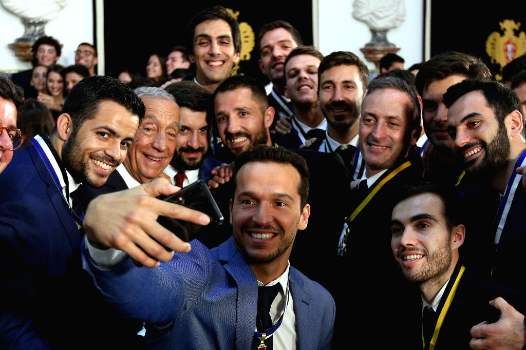 LISBON, July 17, 2019 - Portuguese President Marcelo Rebelo de Sousa (2nd L) takes a selfie with Portugal's national Roller Hockey team during the awarding ceremony for the Portugal's national Roller ...